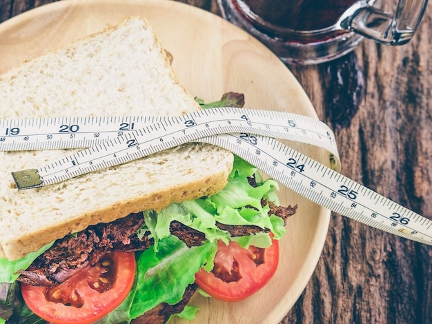 Sandwich with cold soft drink measurement tape as diet concept 1150 6161