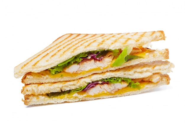Sandwich with ham, cheese, tomatoes, lettuce, and toasted bread. top view isolated. Premium Photo