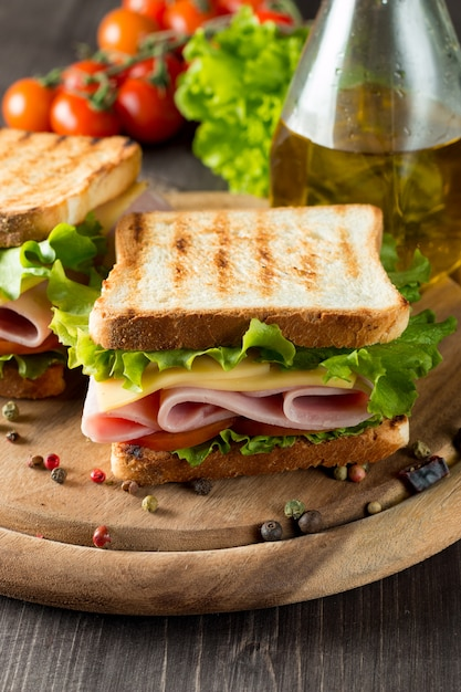 Sandwich with ham and cheese. Premium Photo