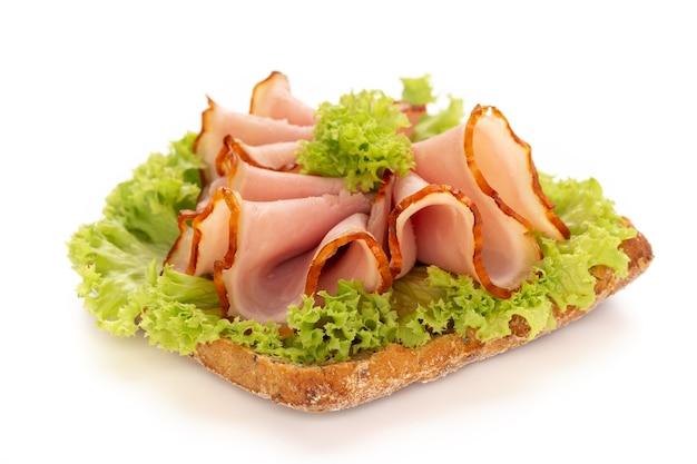 Sandwich with ham sausage on white surface. Premium Photo