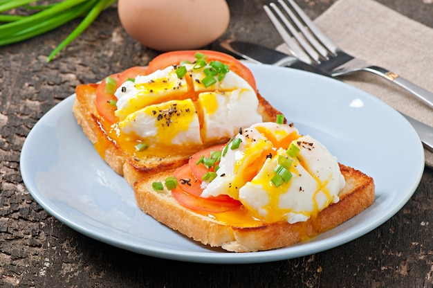 Sandwich with poached egg Free Photo
