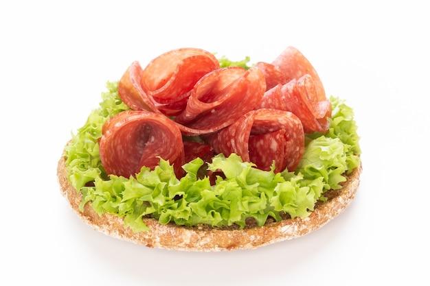 Sandwich with salami sausage Premium Photo