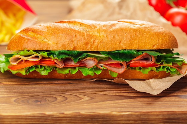 Sandwich on a wooden table Premium Photo