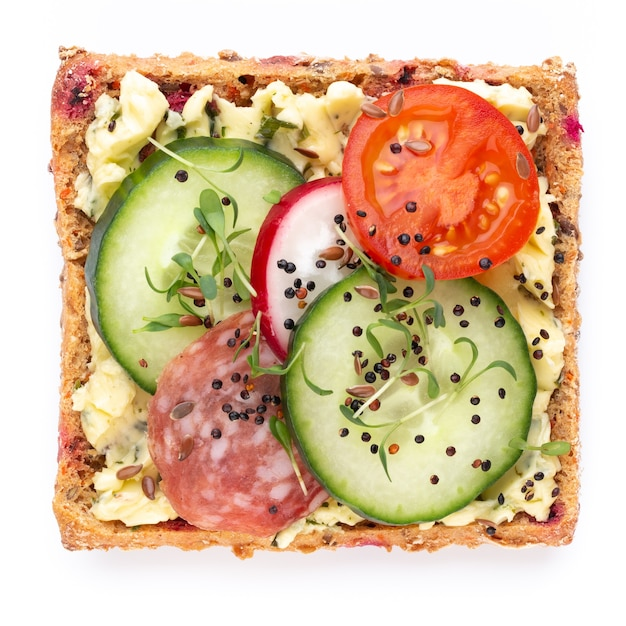 Sandwiches with cream cheese, vegetables and salami Premium Photo