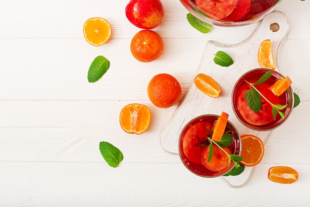 Sangria with fruits and mint on a white Free Photo
