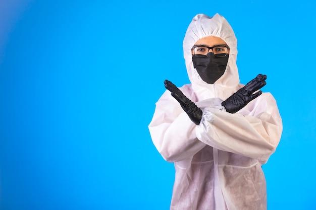 Sanitizer in special preventive uniform makes refusal Free Photo