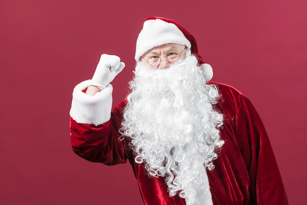 Santa claus in glasses showing fist Free Photo