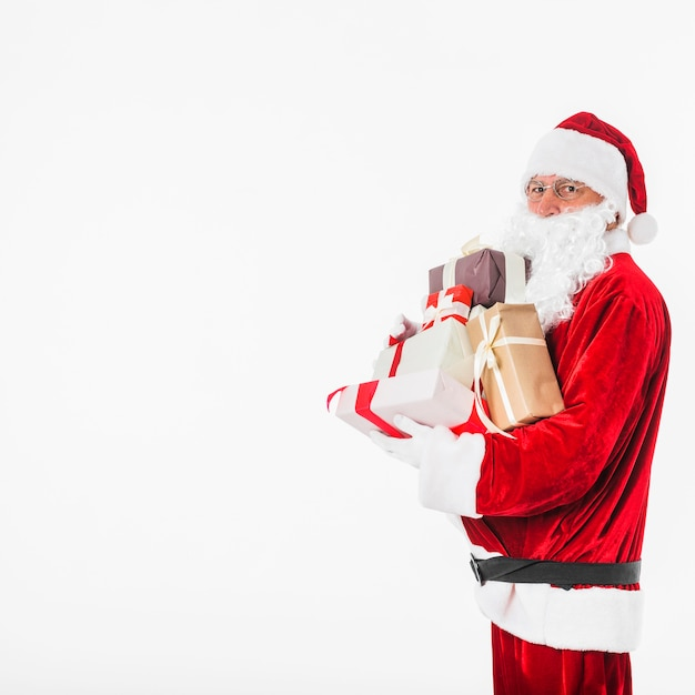 Santa claus in glasses with gift boxes Free Photo