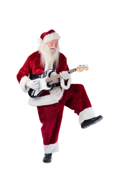 Santa claus has fun with a guitar Premium Photo