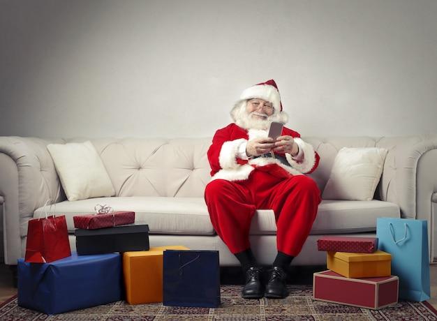 Santa claus and his presents Premium Photo