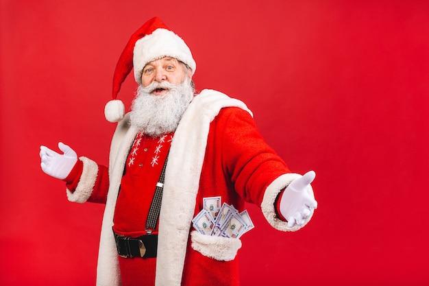 Santa claus holding money Premium Photo