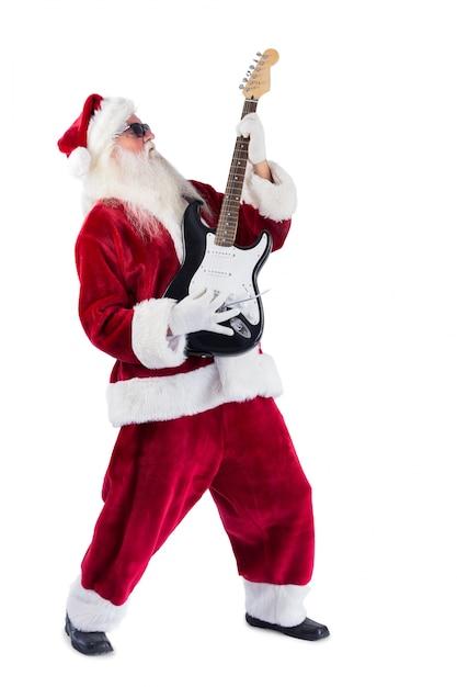 Santa claus plays guitar with sunglasses Premium Photo