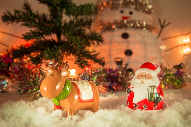 Santa claus and reindeer merry christmas and happy new year Premium Photo