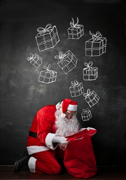 Santa claus searching for a gift Premium Photo