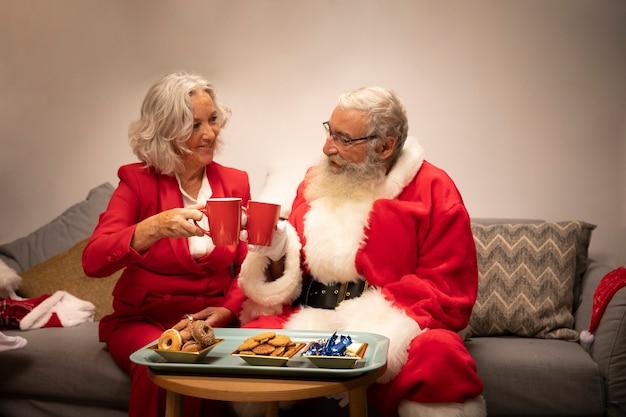 Santa claus and senior woman celebrating Free Photo