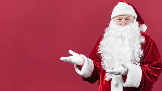Santa claus showing something with hands Free Photo