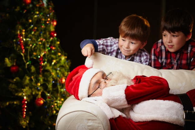 Santa claus sleeping on the couch photo free download