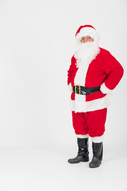 Santa claus standing with hands on hips Free Photo