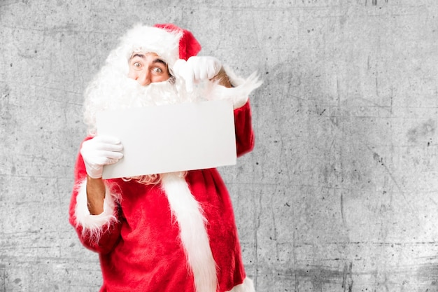 Santa with a white poster Free Photo