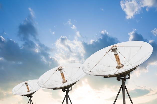 Satellite dish antennas under sky. Premium Photo