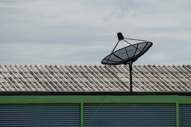 Satellite dish on the roof of the house Premium Photo