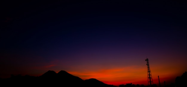 Satellite dishes and communications tower over sunset. Premium Photo