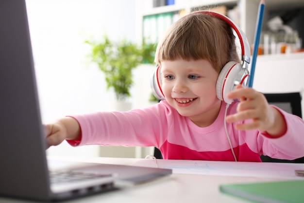 Satisfied child in headphones sitting Premium Photo