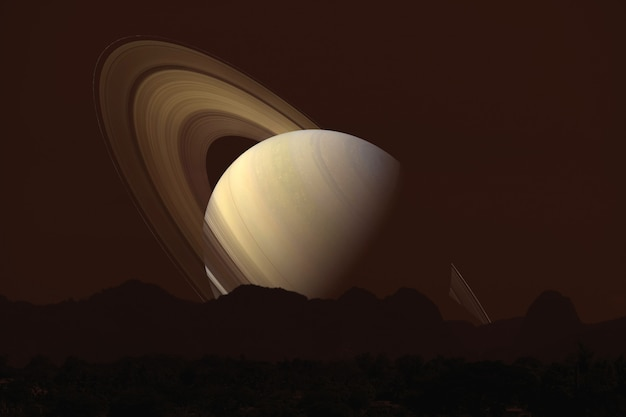 Saturn back  silhouette mountain on cloud and night sky Premium Photo