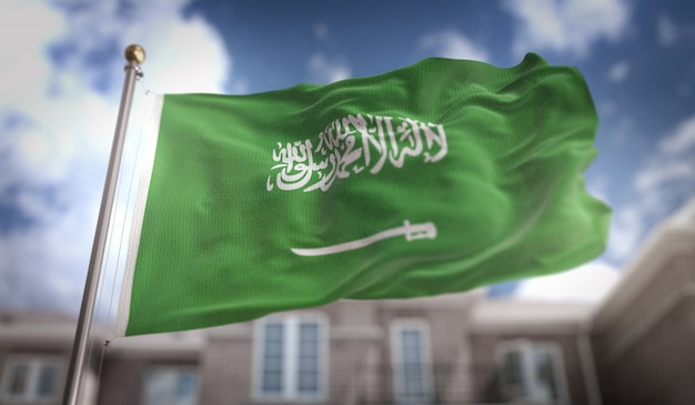 Saudi arabia flag 3d rendering on blue sky building background Premium Photo