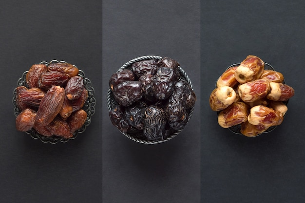 Saudi dates fruits are laid out on a dark table. Premium Photo