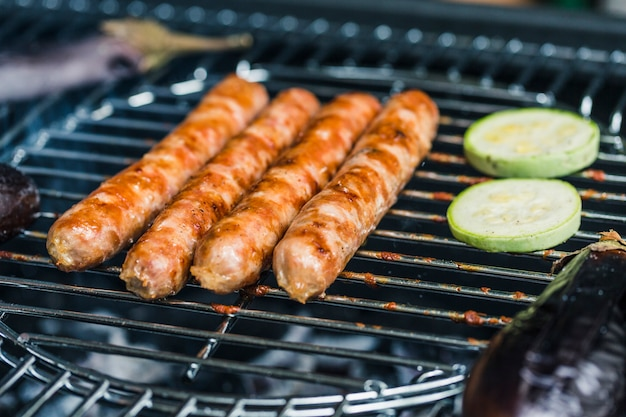 Sausages grilled with vegetables zucchini Premium Photo