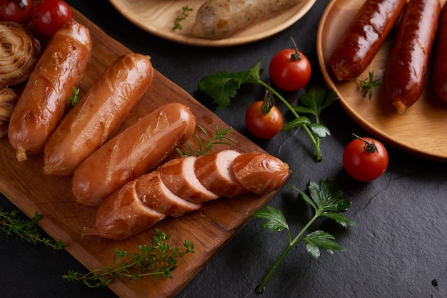 Sausages and ingredients for cooking. grilled sausage with the addition of herbs and and spices Free Photo