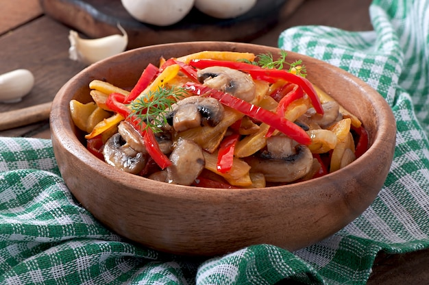 Sauteed mushrooms with pumpkin and sweet pepper Free Photo