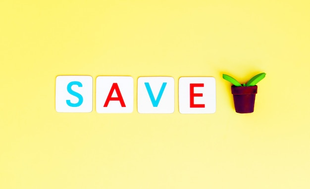 Save tree letter with small plant tree for ecology and earth day concept. Premium Photo