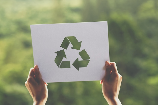 Save world ecology concept environmental conservation with hands holding cut out paper recycle showing Premium Photo