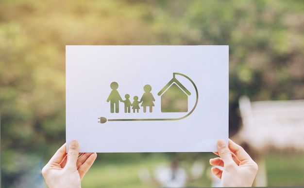 Save world ecology  environmental conservation with hands holding cut out paper earth loving ecology family showing Premium Photo