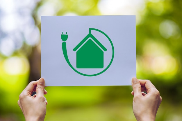 Save world ecology  environmental conservation with hands holding cut out paper showing Premium Photo