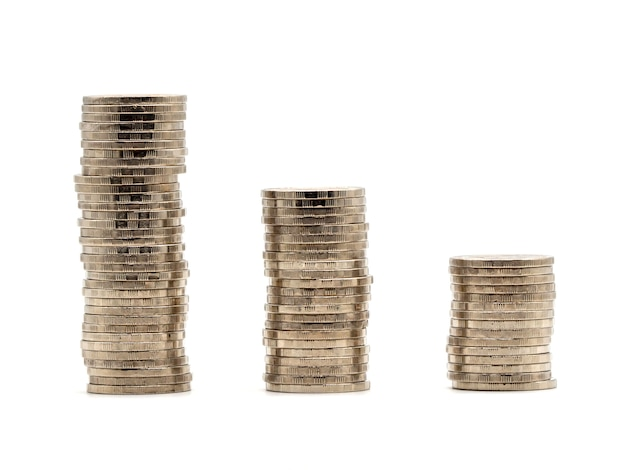 Saving money concept with money coin stack isolated on white background. Premium Photo