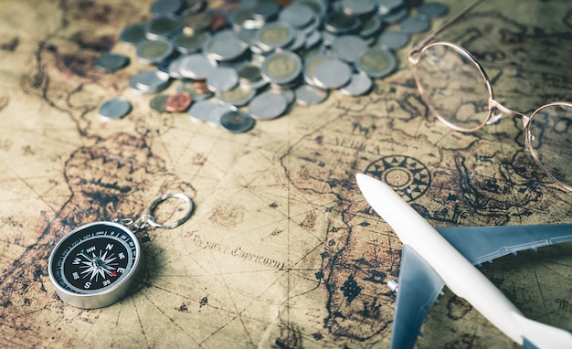 Saving money for world travel on vintage map concept Premium Photo