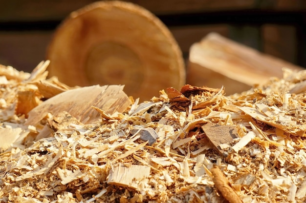 Sawdust with logs background Free Photo
