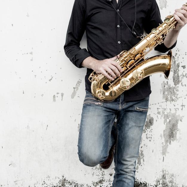 Saxophone symphony musician jazz instrument concept Premium Photo
