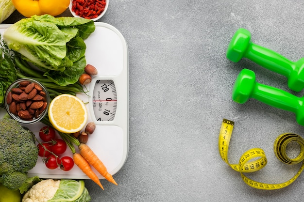 Scale and groceries on slate background Free Photo