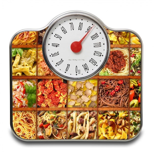 Scales for people with italian pasta on white Premium Photo