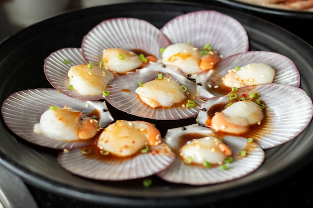 Scallop raw material sea food with ingredient seasonning cook Premium Photo