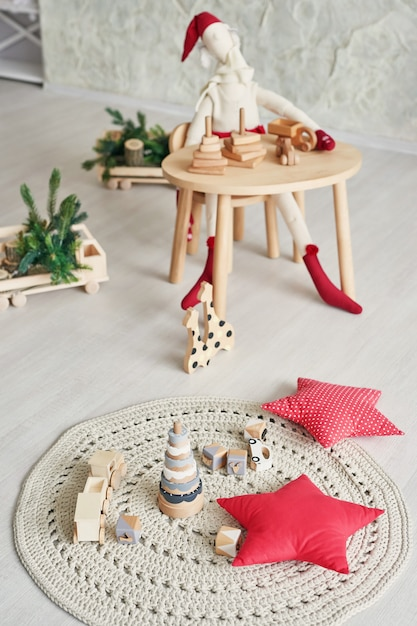 Premium Photo Scandinavian Children Furniture Scandinavian Children S Room With A Christmas Tree Table Chair And Wooden Educational Toys The Interior Of Children S Room In The Loft Style