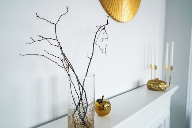 Scandinavian interior in white golden colors, details Premium Photo