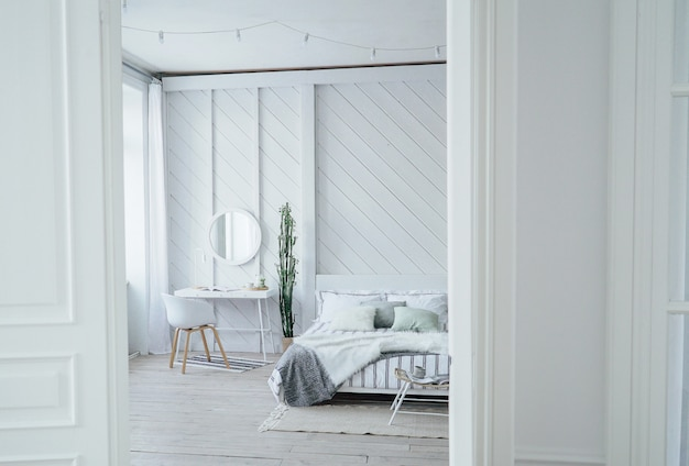 Scandinavian modern cozy eco interior, white table and mirror in bed room, minimalism Premium Photo