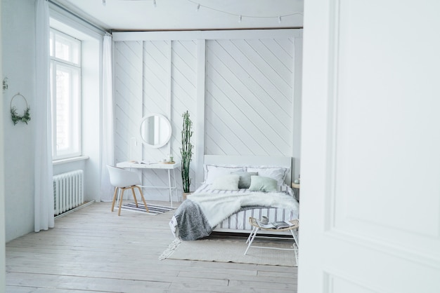 Scandinavian modern cozy eco interior, white table and mirror in bed room Premium Photo