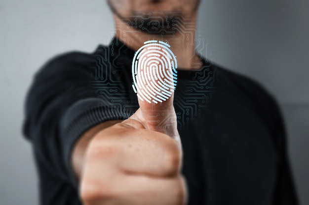 Scanning a fingerprint for identification Premium Photo