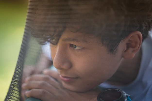Scared and alone, young asian child who is at high risk of being bullied Premium Photo